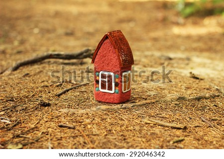 little red house in the forest - stock photo
