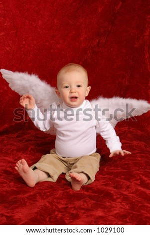 Little redhead boy angel - stock photo