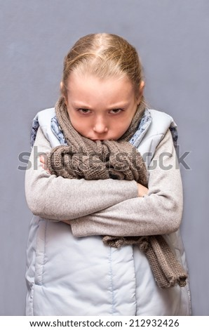 Little sad and angry child. - stock photo