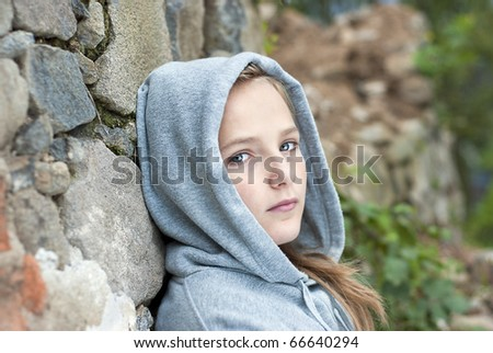 Little sad child is lonesome. - stock photo