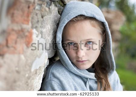 Little sad child with hood. - stock photo