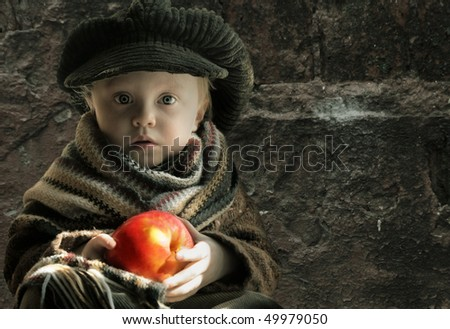 little sad girl with apple, copy space - stock photo