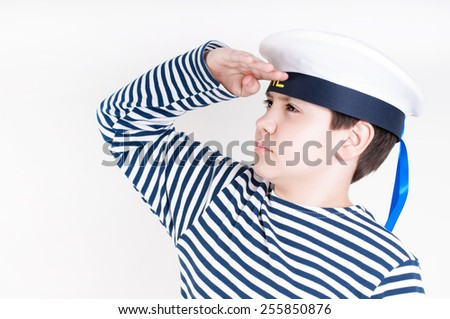 Little sailor in the sea cap  - stock photo