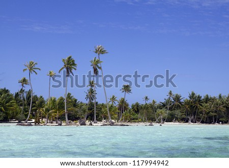little sand island view from a boat in french polynesia - stock photo