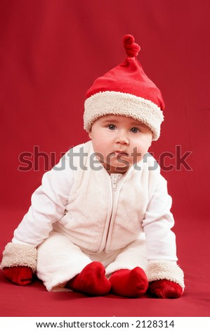 little santa baby on red background
