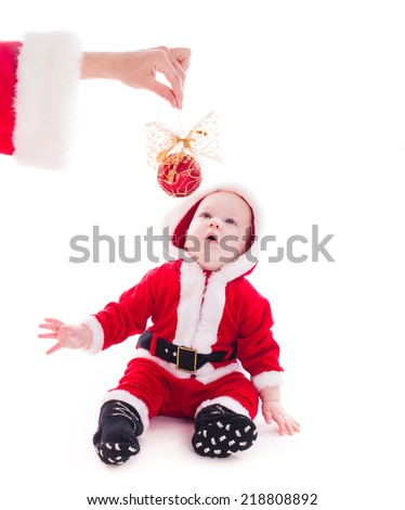 Little Santa boy wants to play isolated on white background - stock photo