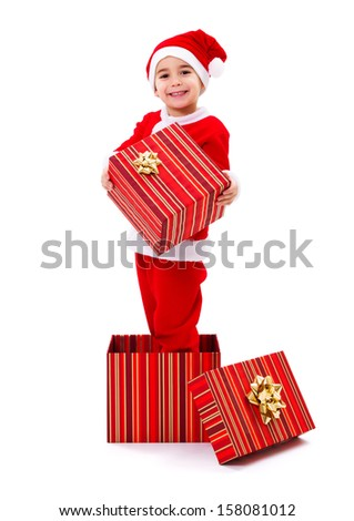 Little Santa Claus boy standing in and holding Christmas gift - stock photo