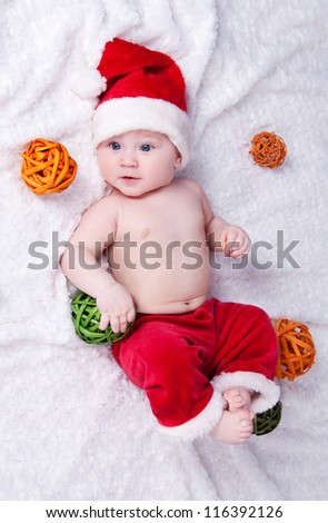 Little Santa Claus with toys lying on a white background. - stock photo