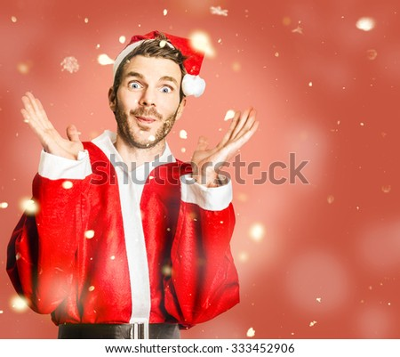 Little Santa helper spreading christmas cheer with open hands in falling snow. What, X-mas already, question mark - stock photo