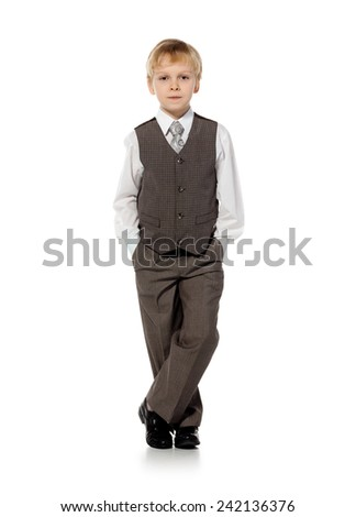 little school boy in suit standing on white background