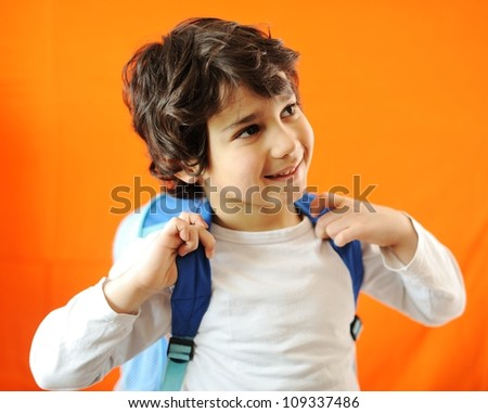 Little school cute boy with backpack - stock photo