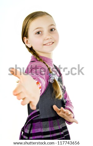 Little school girl reaches out to say hello - stock photo