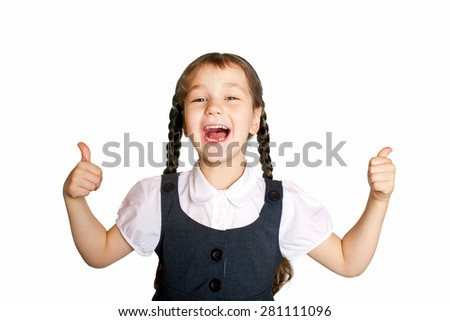Little school  girl showing thumbs up. Back to school! Isolated on a white background.