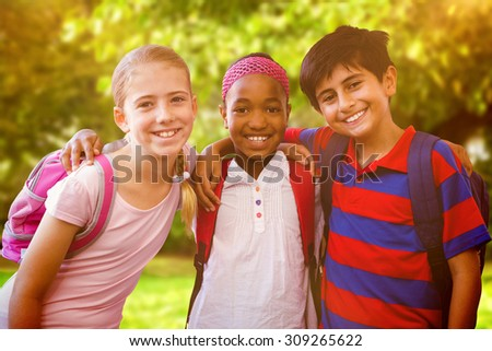 Little school kids in school corridor against trees and meadow in the park - stock photo