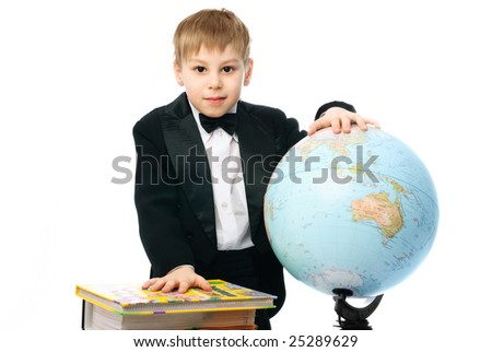 little schoolboy with books and a globe against white background