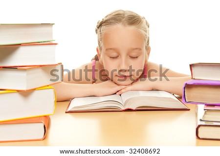 Little schoolgirl fall asleep after reading a book - stock photo