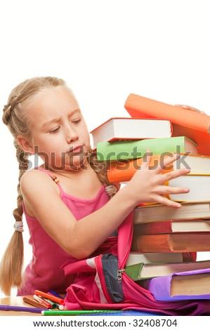 Little schoolgirl packing her rucksack - stock photo