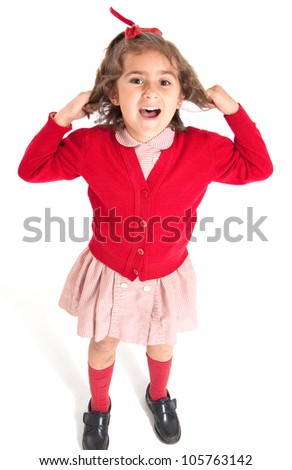 Little schoolgirl with a red uniform pulling her hair - stock photo