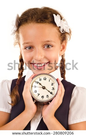 little schoolgirl with clock isolated on a white background