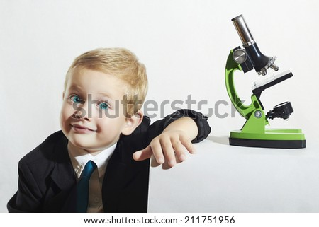 little scientist.fashion portrait of little boy in tie.funny child.Schoolboy working with a microscope.Smart kid.Science - stock photo