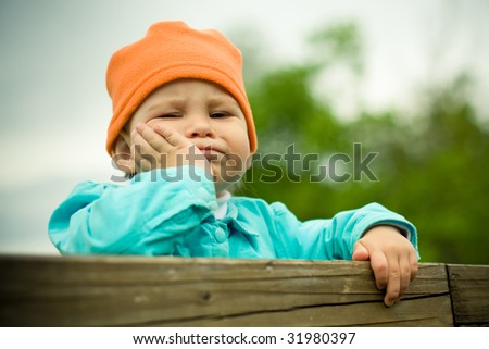 little serious child - stock photo