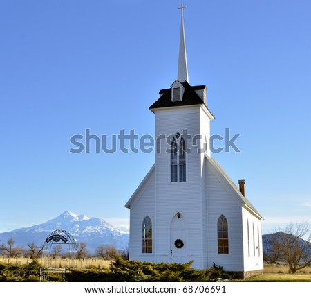 Little Shasta Church, front view, Mount Shasta in the background - stock photo