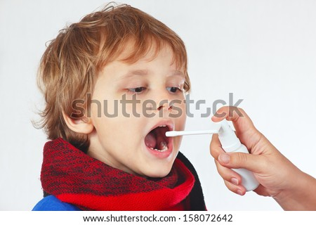 Little sick boy used medical spray for breath  - stock photo