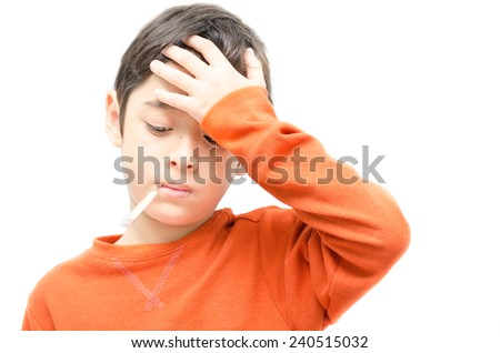 Little sick boy with Thermometer in mouth on white background - stock photo