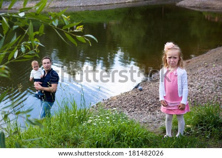 little sister  girl feeling jealousy because of her smaller brother - stock photo