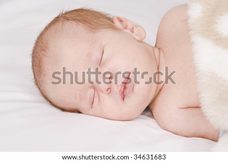 Little sleeping baby - stock photo