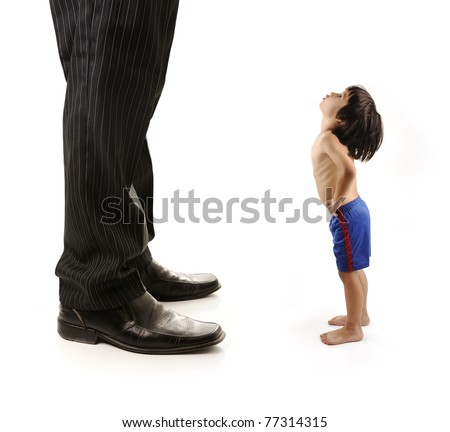 Little small child  is looking at the giant legs of  businessman adult - stock photo