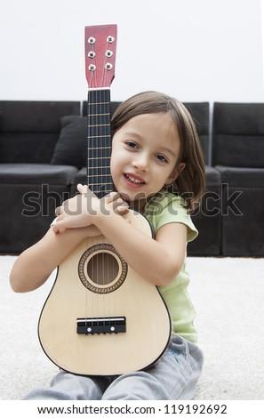little smile  guitar artist girl - stock photo