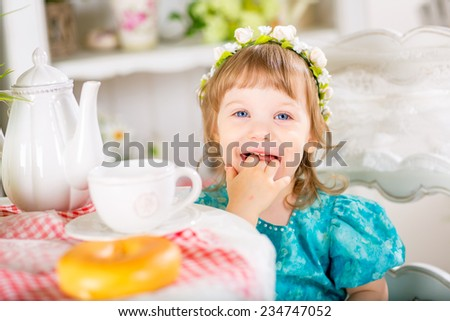 little smiling baby girl have a breakfast - stock photo
