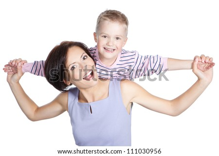 Little smiling boy and his mother hugging each other over white - stock photo