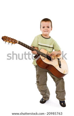 Little smiling boy with acoustic guitar - isolated