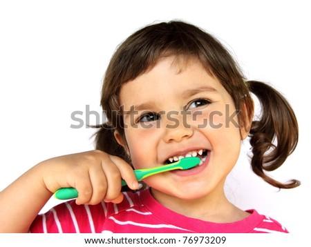 Little Smiling Curly Girl Brushing Teeth Portrait - stock photo