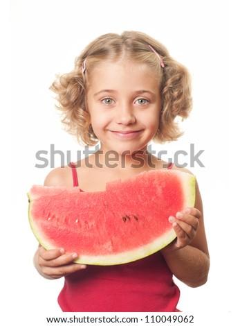 Little smiling girl eating watermelon - stock photo