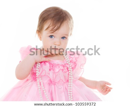 Little smiling girl with a jewel  on white - stock photo