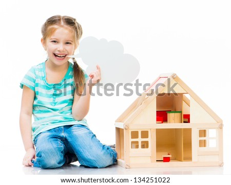little smiling girl with a toy house holding cloud talk - stock photo