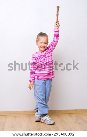 Little smiling girl with painting brush - stock photo