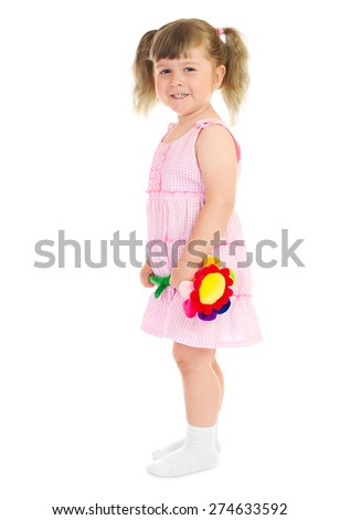 Little smiling girl with toy flower isolated - stock photo