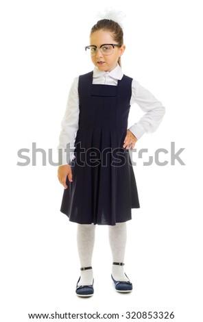 Little smiling schoolgirl isolated on white - stock photo