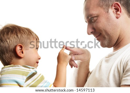 Little son playing with father, close-up. Isolated over white background. - stock photo