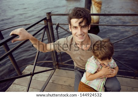 little son with father in city - stock photo