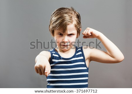 Little Sportive Tough Boy in striped  muscle shirt, Picking a fight - stock photo