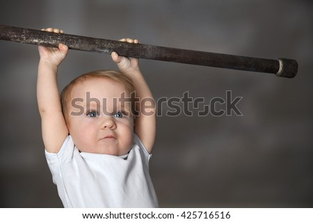 Little strong baby toddler playing sports. Kid during his workout. Success and winner concept - stock photo