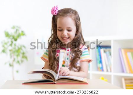 little student child girl studying at preschool - stock photo