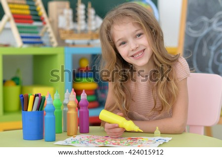 little student girl at art class