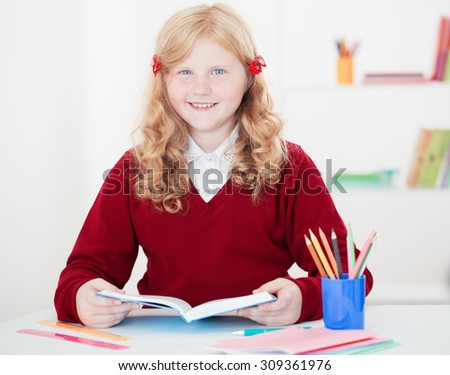 little student girl studying and reading book - stock photo