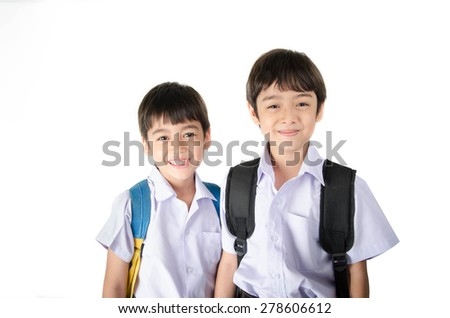 Little student sibling boy in uniform on white background - stock photo